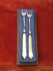 pair silver plated pickle fork